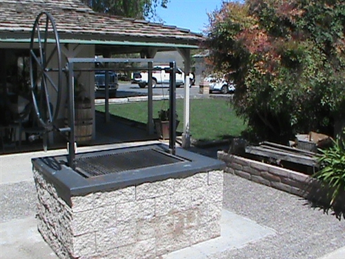 Black Steel Santa Maria Grill with Wheel for outdoor kitchens
