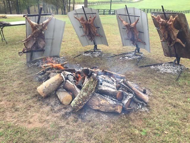 asado-cross-with-adjustable-base-bbq-pig-and-lamb.jpg
